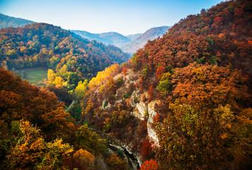 Obraz na Szkle Góry Autumn sunrise on mountain with fog between the hills. National park Djerdap in Serbia.