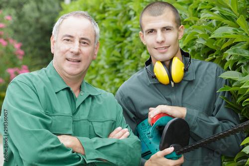 Cuadros en Lienzo two gardeners looking at camera