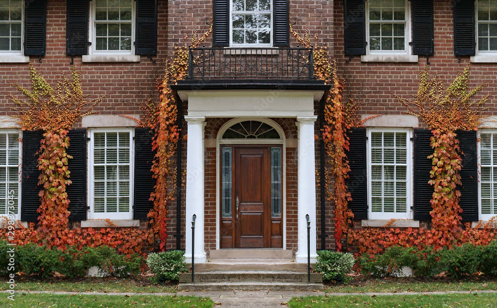 Fototapety, obrazy: Traditional two story brick house with colorful ivy in fall.
