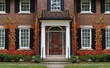 canvas print picture - Traditional two story brick house with colorful ivy in fall.