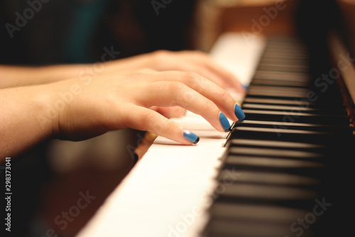 hands playing the piano - 298373041