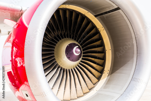 High detailed closeup view on jet airplane engine with red cowling and white bac Canvas Print
