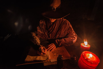 Nostradamus writing his prophesies, fantasy concept. illuminated by candles, long exposure, motion blur, high ISO