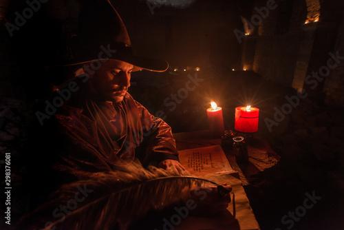 Photo Nostradamus writing his prophesies, fantasy concept