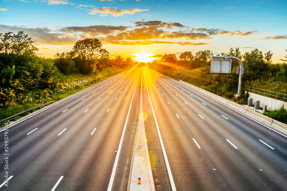 Fototapeta empty UK motorway in England at sunset with no traffic