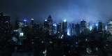 Fototapeta Nowy Jork - New York city at on a foggy night with lights glowing