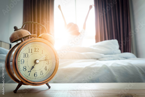 Morning of a new day, alarm clock wake up man sitting in the room Wallpaper Mural