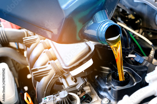 Fotomural  Refueling and pouring oil quality into the engine motor car Transmission and Maintenance Gear
