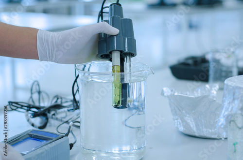scientist used chemical solution and lab testing for water quality or ph meter i Canvas Print