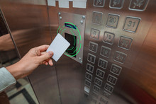 Person Using A Key Card In An Elevator