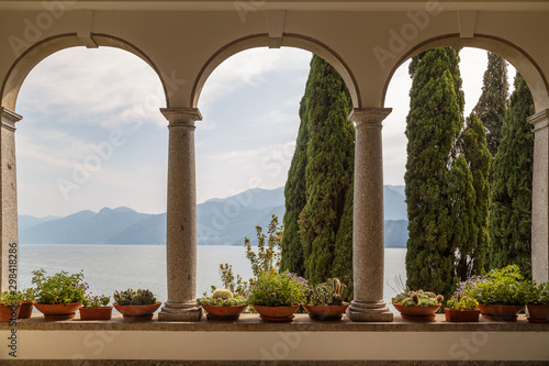 Fotobehang Meer / Vijver VARENNA / ITALY - JULY 2015: View to the garden from the entrance of Villa Monastero, in Varenna town, Italy