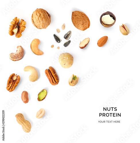 Fotografía  Creative layout made of walnuts, almonds, cashew, pistachio, peanuts, sunflowers and macadamia on white background