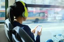 Woman With Headphones Listenin...
