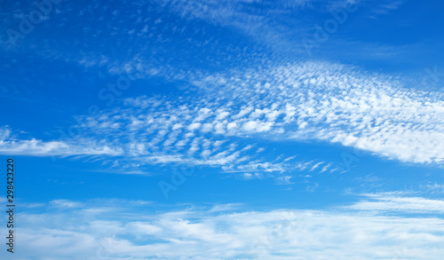Clouds nature background, altocumulus clouds with blue sky. Wallpaper Mural