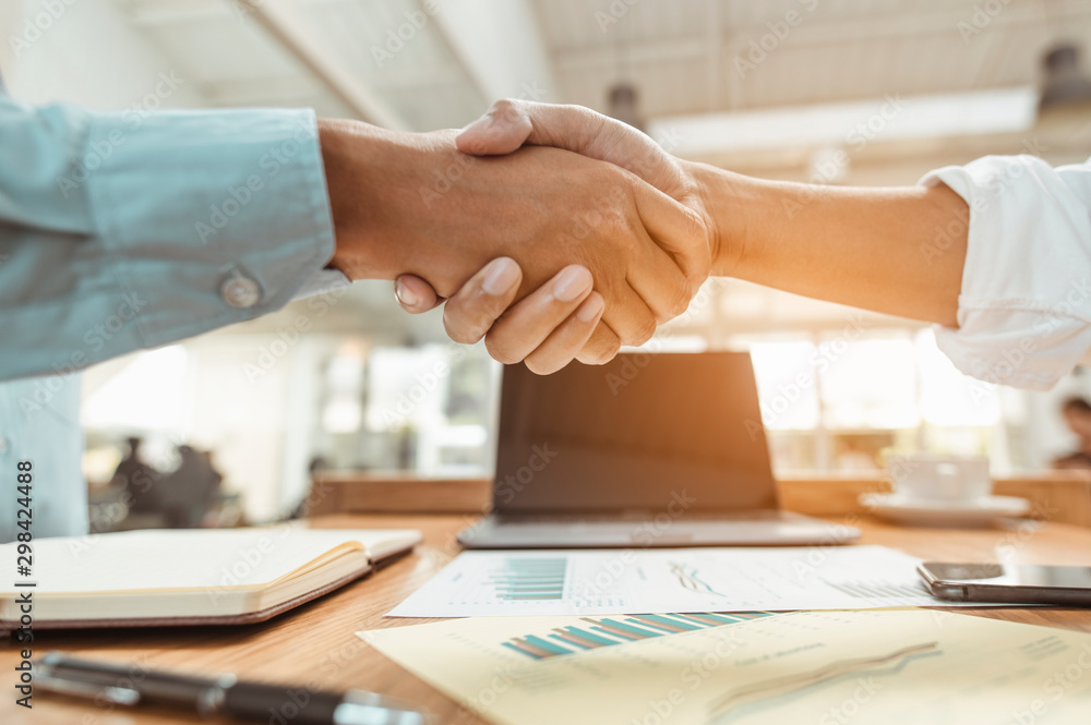 Fototapety, obrazy: Commander handshaking new employee congratulating with starting a new job. Teamwork collaboration concept for business partners, Meetings and greetings concepts.