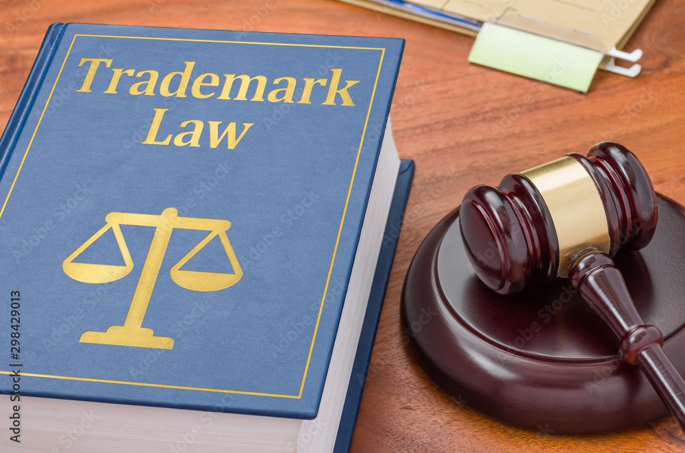 Fototapety, obrazy: A law book with a gavel  - Trademark law