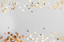 Abstract Christmas Background With Golden Glitter Over White Board.