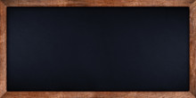 Wide Panorama Dark Stone Slate Blackboard Or Chalkboard With Rustic Wooden Oak Wood Frame Empty Copy Space. School Education Study Concept Background.