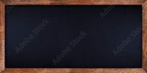 wide panorama dark stone slate blackboard or chalkboard with rustic wooden oak wood frame empty copy space. school education study concept background.