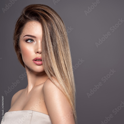 Young woman with long straight hair. Blond girl. Fototapeta