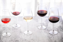 Glasses With Different Wine Bordeaux, Red, Rose  And White On White Background. Beautiful Wine Variety Concept.