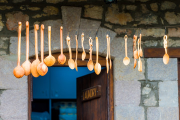 wooden carved spoons in a souvenir shop in a tourist place