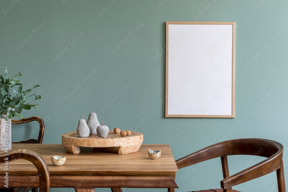 Fototapety, obrazy: Stylish scandinavian dining room interior with mock up poster frame, wooden table, furniture, cup of coffee, plant , cement fruits, nuts and elegant accessories.  Template. Modern home decor.