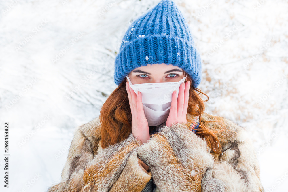 Fototapety, obrazy: young woman in protective mask in winter in outdoors