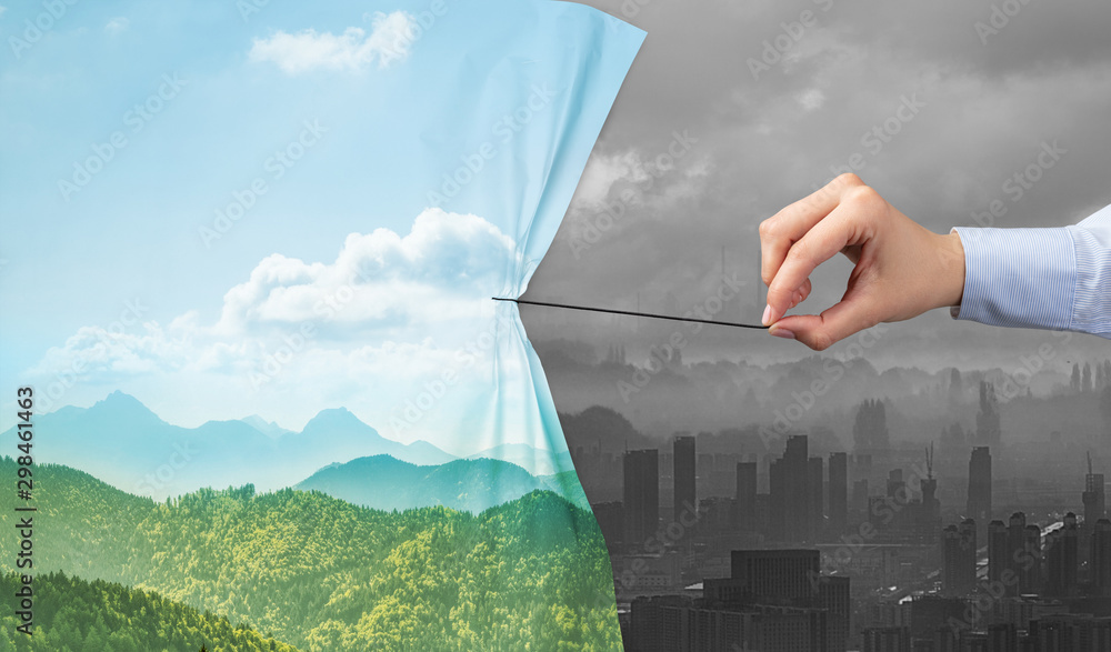 Fototapeta hand pulling nature cityscape curtain to gray cityscape, environmental protection concept
