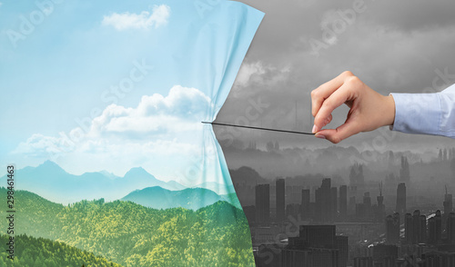 Montage in der Fensternische Indien hand pulling nature cityscape curtain to gray cityscape, environmental protection concept