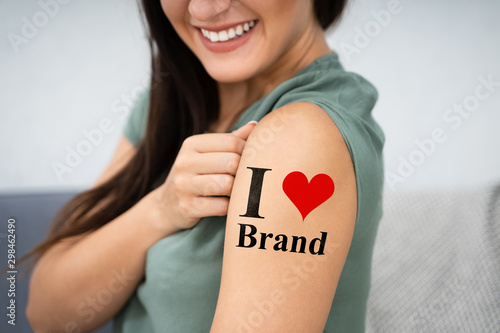 Fotografie, Obraz Woman Showing I Love Brand Tattoo