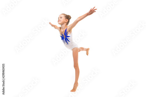 girl gymnast in white trico in full height performs in a white jump isolated on Wallpaper Mural