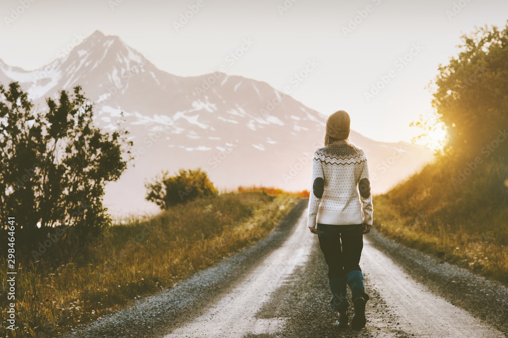 Fototapety, obrazy: Woman walking alone on gravel road in mountains Travel lifestyle adventure vacations escape outdoor