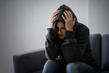 Stressed Woman In Hoodie