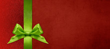 Gift Card Wishes Merry Christmas Background With Green Ribbon Bow On Red Shiny Vibrant Color Texture Template With Blank Copy Space