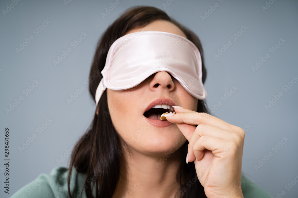 Fototapeta Blindfolded Young Woman Testing Food