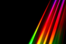 Colourfull Burst Of Prismatic Light Creating Lines Of Blured Motion Against A Black Background