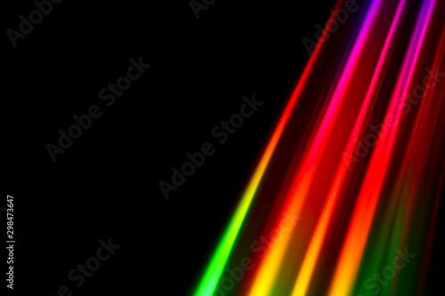 canvas print motiv - Andrew Gardner : Colourfull burst of prismatic light creating lines of blured motion against a black background
