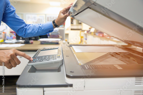 Businessmen are using photocopiers, scanning documents papers in Office Canvas Print
