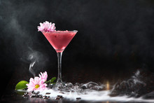 Pink Cocktail On A Black Background In A High Glass. Copy Of Space.