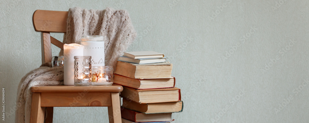 Fototapety, obrazy: Still life home atmosphere in the interior with a book and candles, home decor elements, the concept of comfort and coziness, autumn winter seasonal weekend relaxation