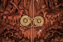Balinese Traditional Door Handle Made With Golden Metal And Wood.