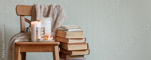 Still life home atmosphere in the interior with a book and candles, home decor e Fototapet