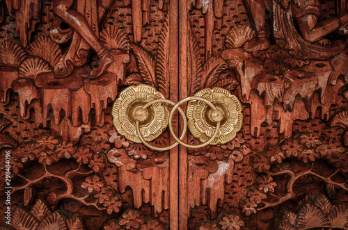 Balinese traditional door handle made with golden metal and wood. Canvas Print