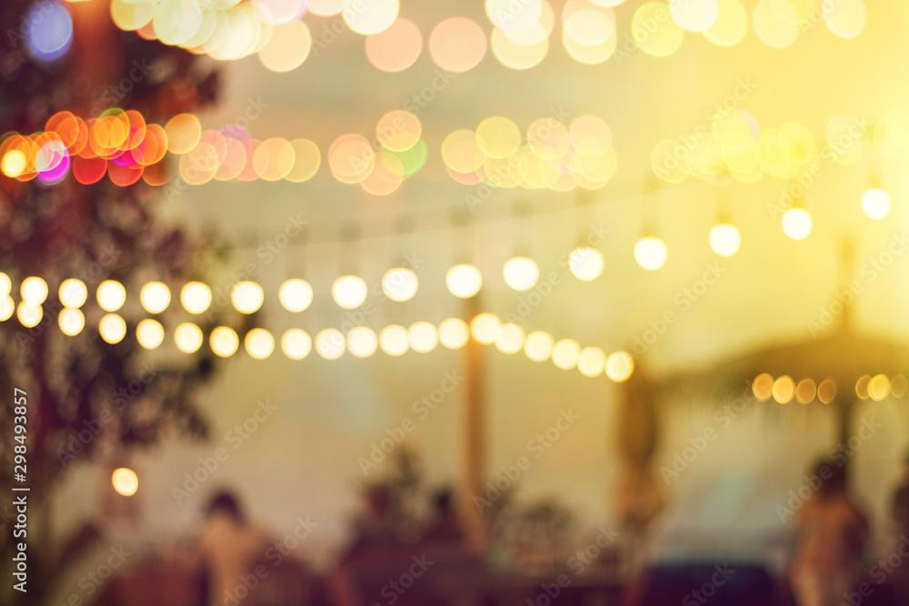 Fototapety, obrazy: blurred bokeh light on sunset with yellow string lights decor in beach restaurant
