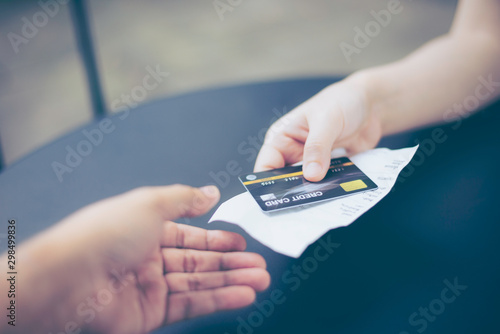 Fotografía  Lady, women hand holding credit card and receipt, bill or order invoice, ready t