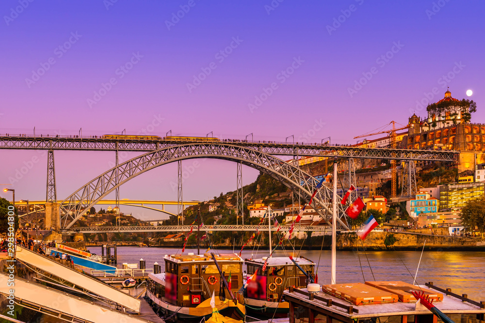 Fototapeta Panorama of the city of Porto on the river Douro at night in Portugal