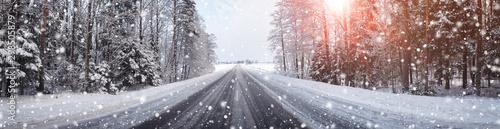 Fototapeta winter road, covered with snow on sunny day obraz na płótnie