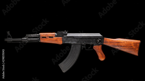 Photo Аssault rifle AK-47 isolated on black. Kalashnikov assault rifle.