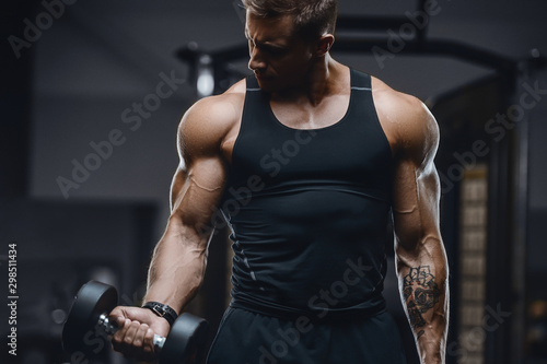 Handsome strong athletic men pumping up muscles workout fitness and bodybuilding concept background - muscular bodybuilder fitness men doing arms abs back exercises in gym naked torso.